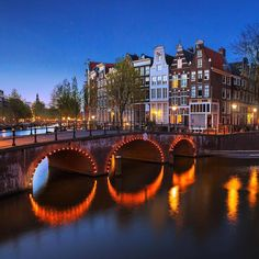 Photo about famous canals of Amsterdam, the Netherlands at dusk. Image of europe, canal, house - 24942582 Visit Amsterdam, Amsterdam Netherlands, Landscape Photography, Travel Photography, Kingdom Of The Netherlands, Amsterdam Canals, World Pictures, Blue Hour, Places To See
