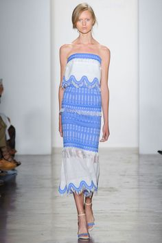A paneled layered dress in blue and white lace feels like occasion dressing for a girl who likes to make an entrance—possible at a beachside wedding in Tulum.    - HarpersBAZAAR.com