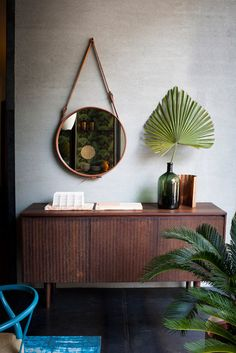 Spotti — StudioPepe Blue work too with a hanging round mirror and fan fern.
