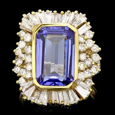 Breathtaking diamond ring with 2cts of diamonds and purple tanzanite centre stone #rings #engagementring #jewelry www.finditforweddings.com