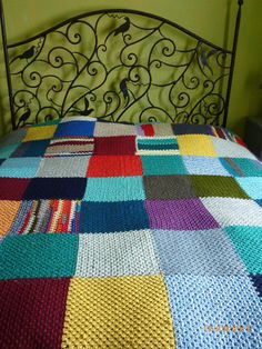 crocheted afghan bedspread full of color