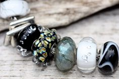 #Trollbeads great combo with #black armadillo, White diamond, , Labradite, Milan, black diamond, frames and white steel.  http://www.trollbeadsjewelry.com/index.aspx  We offer free shipping.