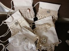 cotton purses with lace and jewel adornments