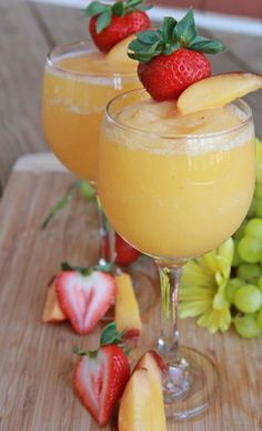 2 cups Peaches, frozen unsweetened. 1/2 cup Powdered sugar. 1 bottle Moscato wine.