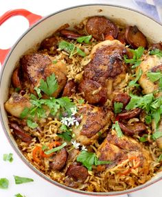 Baked chicken and brown rice cooked in pot together with leeks, andouille sausage for a healthy, easy, nutritious family meal.