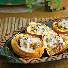 Preheat oven to 400 degrees F. Line a large baking dish with aluminum foil. Place squash, cut side up, in pan. Divide olive oil among squash, placing approximately 1/2 teaspoon oil in each squash. Sprinkle salt and pepper evenly over squash.