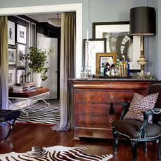 Artwork - layered over cabinet and in hall above bench