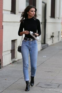 When Emily Ratajkowski stepped out to shop in LA, she didn't go all out with her outfit. The actress wore a simple black turtleneck, cuffed denim jeans, and