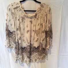 Band of gypsies top This top is in perfect condition.  It is flowy and can be worn on or off the shoulder Band of Gypsies Tops Blouses