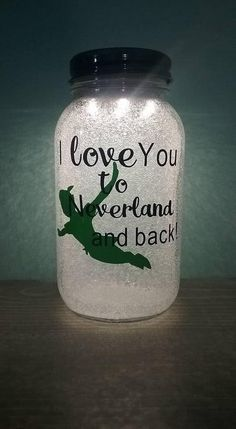 I Love you to Neverland and back Nightlight Inspired by Peter Pan Includes a Green Lid, Green Peter Pan and Navy Blue writing. (Can be customized) 2 AAA Batteries included Quart Mason Jar