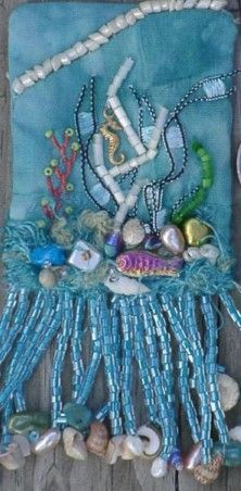 mini sea pouch, this site has wonderful info on simple crazy quilting and sources.  Thank goodness for sharing artisans....