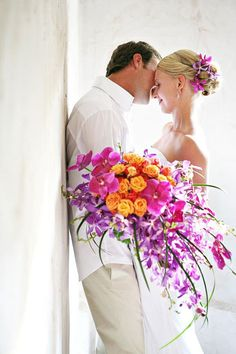 Colorful bridal bouquet « Bollea – Floral Design Gallery >> A colorful, cascading bridal bouquet with phalaenopsis, Dendrobium and mokara orchid surrounds orange sweetheart roses. Created by The Flower Studio.