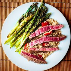 Baked asparagus, cherry tomatoes couscous and beef steak! - MANGIO QUINDI SONO