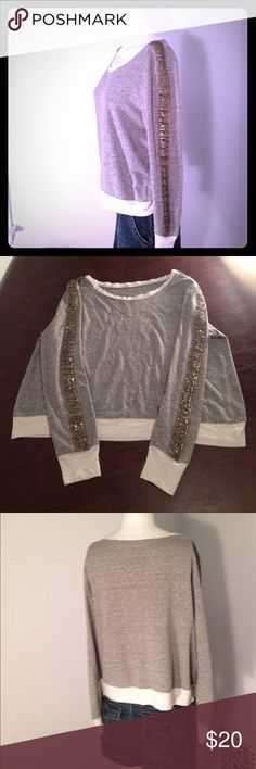 Gibson beaded embellished sleeve sweatshirt Gibson beaded embellished sleeve sweatshirt. Size medium. Gray with white trim has gold tone colored beading down both sleeves . Very cute . Good condition Gibson Tops Sweatshirts & Hoodies