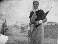 Holding a parasol and notebook, Matron (Margaret) Grace Wilson