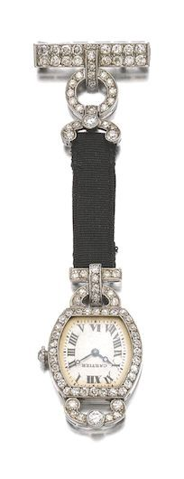 DIAMOND FOB WATCH, 'TORTUE', CARTIER, 1926 The dial with blued steel hands and Roman numeral indicators, set within a frame of circular- and single-cut diamonds, length approximately 90mm, signed Cartier, numbered, French assay marks.