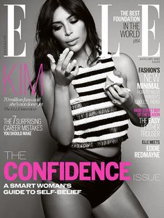 Kim Kardashian eats a cupcake and wears a striped crop top on the cover of ELLE UK // Photo by Jean-Baptiste Mondino