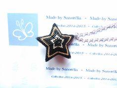 2014/052- Pendentif + Chaine - style etoile 3D - tissage peyote - perle en noir argenté et doré : Pendentif par sanorelia