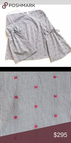 Tanya Taylor Menswear Martine Top Fuchsia stars dot a navy and white pinstripe for a fresh take on a menswear classic. Paired with a feminine skirt for balance, this tailored-fit top is ideal for transitioning between seasons. Tanya Taylor Tops Blouses