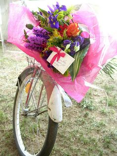 Some lucky person is getting flowers delivered via bicycle!