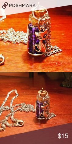 Pixie dust bottle Necklace Long stainless steel chain with tiny bottle filled with purple pixie dust, with an adorable cute cat charm. Handmade design. Magen's Fairytale Creations  Jewelry Necklaces