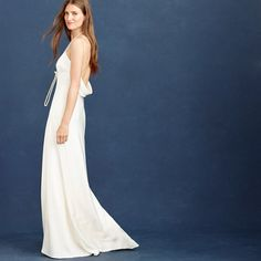 Part long slip dress, part proper gown, totally impressive. A sleek, streamlined silhouette means you can keep things simple or add some statement jewels, depending on the vibe you're going for, while a plunging back detail ends in a sexy draped cowl for a little unexpected drama (the good kind).