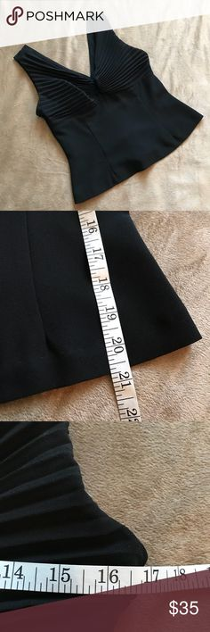 JOSEPH RIBKOFF Vintage Size 6 Top Black Blouse This listing is for a Joseph Ribkoff top. It's in fantastic condition. I love the classic details on the bust. Very classy top! Back zipper works great. Sleeveless and black. No holes or stains.   Size 6  Smoke free home  Feel free to ask questions! Joseph Ribkoff Tops