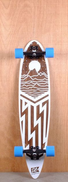 "DB PREBUILT 38"" CASCADE LONGBOARD COMPLETE  The DB Prebuilt 38"" Cascade is designed for carving and cruising. Pressed from 6 plies hard rock maple with a walnut sandwhich, it measures 38"" long and 8.75"" wide. The pintail platform has radial concave and flex for push comfort. Wheel wells to reduce the chance of wheel bite."