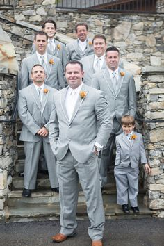 Groomsmen in light gray suits + orange boutonnieres {Jewels Photography}