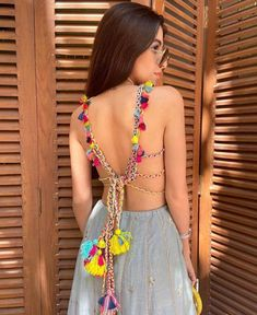 backless blouse designs for lehenga with dori and tassels Indian Bridal Outfits, Indian Fashion Dresses, Indian Designer Outfits, Stylish Blouse Design, Fancy Blouse Designs, Lehenga Designs, Saree Blouse Designs, Designs Mehndi, Choli Designs