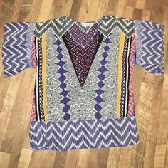 Bright colored top Multi colored loose fitting top. The sleeves are semi belled. I love the colors and designs in this top! Cato Tops Blouses