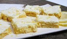 Cream Cheese Lemon Bars Recipe 1 box lemon cake mix cup butter or margarine - softened 1 egg 8 ounces cream cheese - softened 1 cup powdered sugar lemon - grated 2 tablespoons lemon juice or fresh squeezed lemon 2 eggs 1 teaspoon vanilla Lemon Desserts, Lemon Recipes, Just Desserts, Sweet Recipes, Delicious Desserts, Dessert Recipes, Yummy Food, Lemon Cream Cheese Bars, Lemon Bars