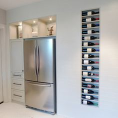 This kitchen remodel includes a recessed wine rack, with each shelf built on a four degree slope to ensure the bottles stay in place.