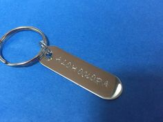 Hand stamped Stainless Steel keyring Size: 45mm x 13mm - 22g polished Stainless Steel (stainless steel looks just like silver however it is stronger and doesnt tarnish)  Choose a charm to enhance your pendant  You can have up to 2 lines of 10 characters on each line.  Ideas for stamping include initials, names, birth dates of children, grandchildren, even your furry children; your pets! You might also consider inspirational words or meanings, words that best describe your favorite sport…