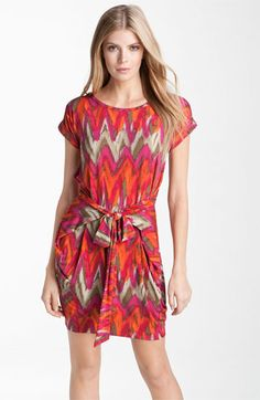 Love the bold print, bright colors, and cap sleeves. Try this MICHAEL Michael Kors Print Wrap Waist Dress available at Nordstrom!