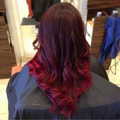 Brunette, brown hair with red highlights. Ombré hairstyles. Hairdye
