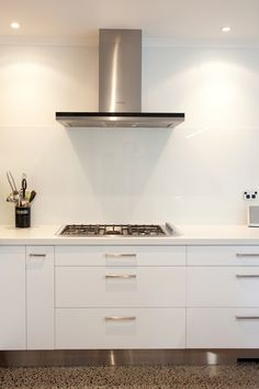 Polished concrete creates a stylish surface, that involves a clear coating over visible dark pebbles and lighter concrete mix. New Homes, Polished Concrete, Concrete Mixes, House, Kitchen, Home, Concrete, Home Decor