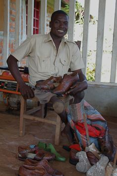 Balia, the shoemaker -  in Congo, Africa  by: Naomi Norris