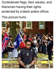 This photo is powerful. This is Charlottesville Police Officer Nash serving our community and protecting the KKK's first amendment rights even though the very people he is protecting hate him because of his race. Officer Nash is a hero in my eyes. Black Power, We Are The World, In This World, Intersectional Feminism, Trump, Faith In Humanity, Look At You, Social Issues, Social Justice