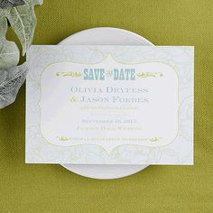 This white card has your upcoming wedding information listed in the middle with a western look to it. There are flowers outlined in green that encompass your wording.