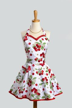 If I ever have to put on an apron, please let it look like this: retro cotton fabric in a cherry print with trim at neckline and hem