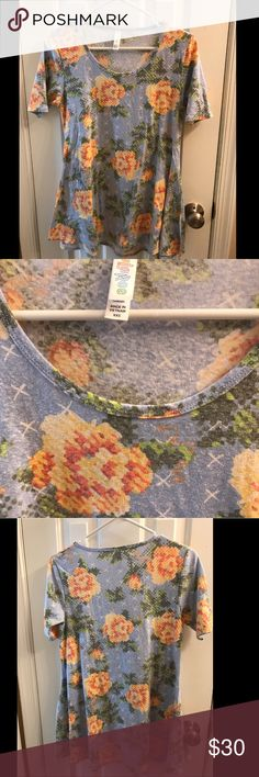 LuLaRoe Perfect Tee (worn once) LuLaRoe Perfect Tee, size xxs, light blue background with white x's and with peach flowers/green leaves. Worn one time and washed per LuLaRoe instructions. Selling because I'm trying to make room in my closet. LuLaRoe Tops