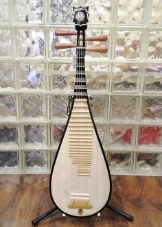 Shanghai Dunhuang Pípa (琵琶) Chinese lute instrument, a plucked Chinese musical instrument with four strings.  Sometimes called the Chinese lute. It has a pear-shaped wooden body.