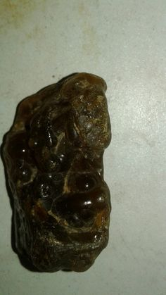 Is it a carnelian or amber or some old carved stone I don't know