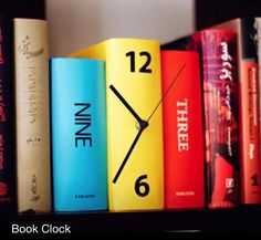Give your book collection a unique touch with this book clock. Designed to look like three colorful books standing next to each other, this clever clock will inconspicuously fit right in on your book shelf, and makes a great house warming gift idea. Book Clock, Book Art, Diy Clock, Clock Ideas, Clock Wall, Clock Decor, Wall Décor, Wall Art, Diy Recycling