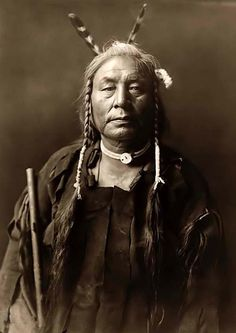Atsina Indian Warrior - The Atsina were a Native American tribe that migrated on the plains between the Missouri and Saskatchewan Rivers. In 1888 the Atsina were moved to a reservation at Fort Belknap, Montana. Photo: Northwestern University Library via National Geographic.