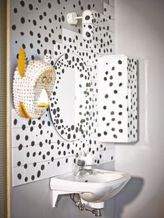 Let's get dotty! Add immediate texture across your wall – even the mirror and cabinets are not immune to your dot prowess. Best solution: cut up black tape into all different kinds of sizes.
