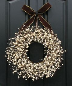 Front door decoration - red berries, grey burlap bow. Description from pinterest.com. I searched for this on bing.com/images