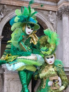 Stunningly beautiful in green, with a monkey in the cage.  Venice Carnival 2015 by Lesley McGibbon