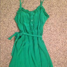 Green Forever 21 Dress 100% silk Worn twice. Beautiful green in color. 100 silk. Belt. Because it is all silk it is somewhat fragile and should be handled with care. Super versatile just doesn't fit me anymore Forever 21 Dresses